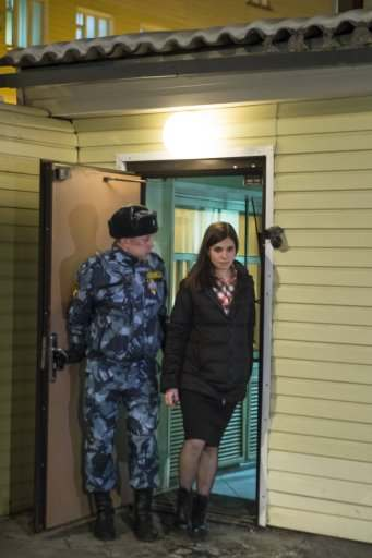 Nadezhda Tolokonnikova, right, leaves prison in Krasnoyarsk, Russia, Monday, Dec. 23, 2013. The third member of the Russian punk bank Pussy Riot has been released from custody following an amnesty law passed by parliament. Tolokonnikova left the prison colony in the eastern Siberian city Krasnoyarsk on Monday, hours after another band member, Maria Alekhina, was released in another region. (AP Photo/Tatyana Vishnevskaya)