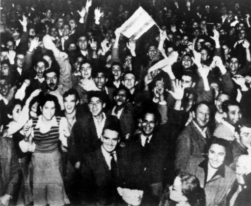 Jewish residents wave jubilantly in the streets in Tel Aviv, Israel. Celebrations began after the United Nations voted to partition Palestine into separate Jewish and Arab states.
