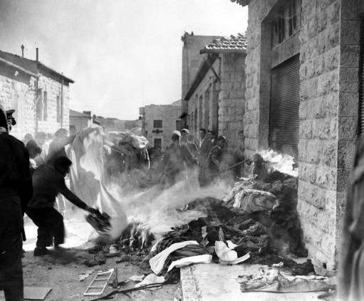 A crowd of arab demonstrators burn goods taken from Jewish homes in Jerusalem, Dec. 6, 1947, during the disturbances which broke out as the arabs staged a three-day strike against the partition plan. Jewish shops and homes in the quarter were attacked and some set on fire.