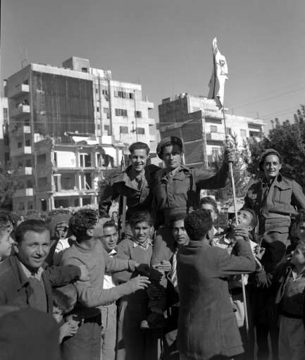 Jews who have been the enemies of the British for the past few years, have made up after hearing of the news of the declaration of the new Jewish State of Israel. Jews are seen hoisting British soldiers on their shoulders and holding the Israeli flag on Nov. 30, 1947 in Jerusalem.