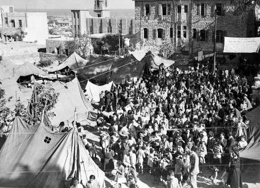 Some of the thirteen hundred Palestinian Armenian from Jaffa, Jerusalem and Haifa, in the tent camp in the grounds of the Armenian Church, Haifa, Oct. 29, 1947, where they are waiting for transport to Soviet Armenia.