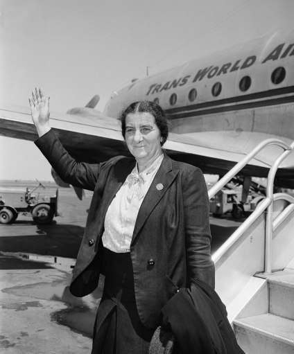 "Mrs. Golda Meir is the only female member of the provisional council of the new state of Israel, waves following her arrival at La Guardia Field, New York, May 19, 1948 from Jerusalem. She declared that ""if the United state arms embargo is lifted, we can drive the Arabs out in a few weeks."" She added that the Jewish people in Palestine were optimistic of the successful outcome of the war because finances and manpower have been solidly mobilized."