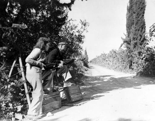 Members of the Jewish Defence Oraganisation Haganah, armed with sten guns, keep guard in an orange grove, near Rehovoth, Palestine, March 8, 1948, after arabs had attacked Jewish buses and convoys in the area.