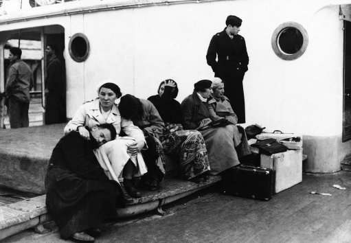 The tired groups shown above on the ship King Carol were a part of 318 homeless Jews barred from entering Palestine by the Quota system restricting immigration on Dec. 5, 1934. For two months they wandered vainly seeking a country where they would be permitted to land. Finally the polish government consented to receive them and they were landed at Constanza, Roumania and transported to Poland by train.