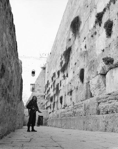 An Arab, armed with a sub-machine gun, stands guard at Jerusalem's Wailing Wall on Feb. 23, 1948. Jews are being kept from this centuries-old holy place by Arabs for the first time since the Arab-Jewish disorders in 1939.