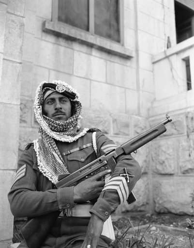 An Arab legion soldier fingers a machine gun as he stands guard in Jerusalem on Jan. 6, 1948 where his army is on loan to the British army to help out because of shortage of British soldiers in the holy land. (