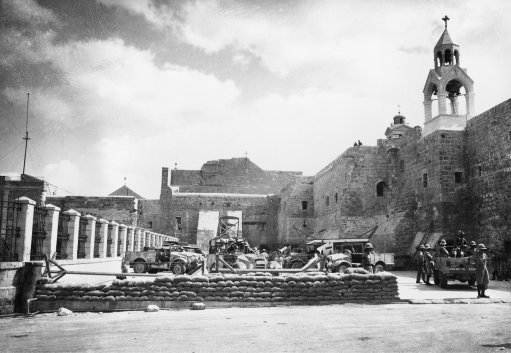 British machine guns and sandbag barricades are set up in the courtyard of the Church of the Nativity in Bethlehem, Palestine, Oct. 26, 1938.