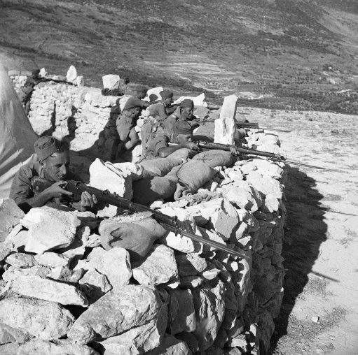 The British Army, strengthened by newly arrived reinforcements from England, Malta, India, and Egypt are conducting an intensive drive against Arab Rebels in historic Galilee, Northern, Palestine. British riflemen in action against Arab rebels at a mountain outpost in Israel on Nov. 10, 1938.