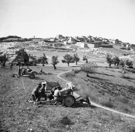 British troops, reinforced by new arrival's are concentrating on the Galilee area north Palestine, in the General hunt for Arab rebels on Jan. 11, 1938. New rubber tired British 3.75 howitzers bombarding rebels in the Galilee (north Palestine) area.