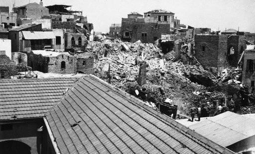 In order to destroy the strongholds and hiding places of anti-Jewish Arab rioters in this city British troops were detailed off to blow up the older portions of the city with dynamite. Other troops were posted throughout the town to deal with hostile Arab demonstrations from those who had been evicted. The demolition also cleared the way for the building of new roads. A general view of the older part of Jaffa, Israel on July 3, 1936 after buildings had been blown up with dynamite. (AP Photo)
