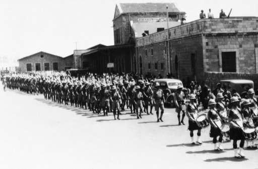 The second battalion of the Dorsetshire regiment was moved into the holy land to reinforce those quelling Arab-Jew riots. The troops are shown being piped into Jerusalem by the band of the Second Battalion on June 22, 1936. The queen's own Cameron Highlanders