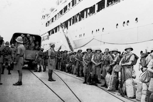 This time suppression of the Arab rebellion in Palestine is the British soldier's lot. After months of terrorism, loss of lives in the hundreds and loss of trade in the millions, Britain apparently is determined to halt the terror and is dispatching thousands of additional troops. Photo shows Tommies after disembarking from a transport at Haifa on Oct. 11, 1938, when they were to be assigned to the duties in Jerusalem and other disturbed points.