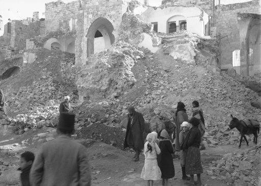 "Funds are being raised in Nablus to rebuild the structures demolished by British troops during the Arab ""Reign of terror"". The ruins of a building in Nablus which the British Blew up because it was used by Arab snipers on Jan. 12, 1937."