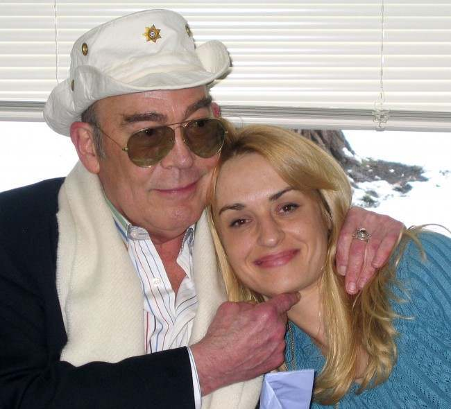 Hunter S. Thompson and his wife, Anita Thompson during their civil wedding ceremony, April 23, 2003, in Aspen, Colo. Hunter S. Thompson's ashes are to be blasted from a cannon mounted inside a sculpture of the journalist's ``gonzo fist'' emblem, his wife Anita said Tuesday, April 5, 2005. The cannon shot, planned sometime in August 2005, on the grounds of his Aspen-area home, is to fulfill the writer's long-cherished wish. Thompson, 67, shot himself in the head on Feb. 20, 2005. (AP Photo/Louisa Davidson, File)