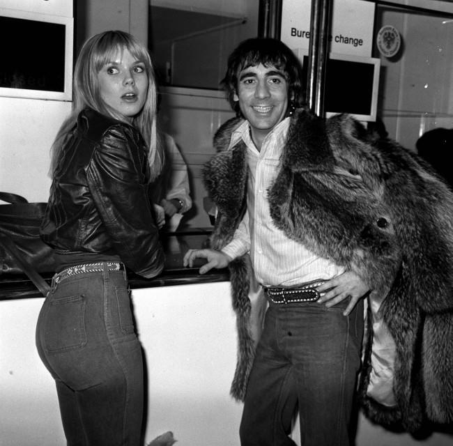 Keith Moon, the eccentric drummer of The Who, at Heathrow Airport with his girlfriend Annette Walker-Lax, on return from the United States. PA/PA Archive/Press Association Images