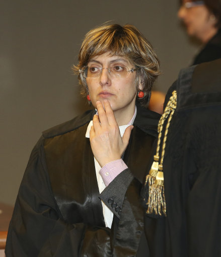 Giulia Bongiorno, lawyer of Amanda Knox's ex-boyfriend, Raffaele Sollecito waits for the verdict for the murder of British student Meredith Kercher, in Florence, Italy, Thursday, Jan. 30, 2014. An appeals court in Florence upheld the convictions of U.S. student Amanda Knox and her ex-boyfriend for the 2007 murder of her British roommate. Knox was sentenced to 28 1/2 years in prison, raising the specter of a long legal battle over her extradition. After nearly 12 hours of deliberation Thursday the court reinstated the guilty verdict first handed down against Knox and Raffaele Sollecito in 2009. (AP Photo/Antonio Calanni)