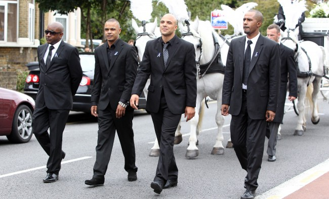 The brothers of police shooting victim Mark Duggan, Shaun Hall (left) and Marlon Duggan (second left) lead his funeral cortege as it makes its way to the New Testament Church of God in Wood Green, north London.  Picture date: Friday September 9, 2011. Mourners turned out today to bid a final farewell to the police shooting victim whose death sparked the first night of devastating riots across England. Amid lingering tensions between family members and detectives, the ornate cortege carrying the body of Mark Duggan made its way to his private funeral after passing through North London's Broadwater Farm estate.