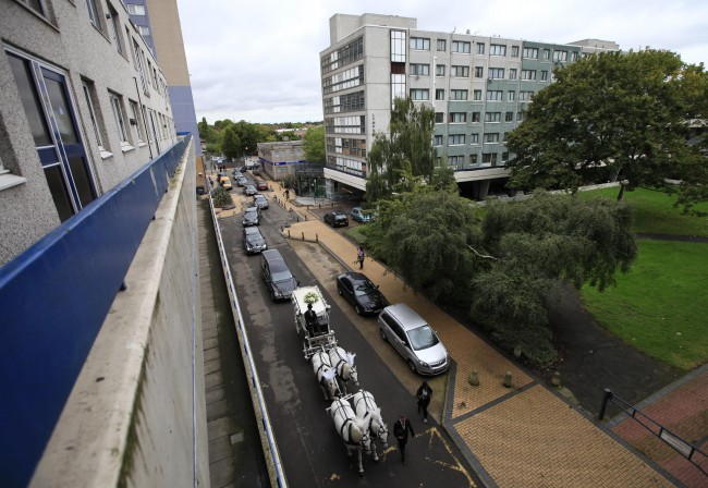 A hearse carrying the coffin of Mark Duggan, whose death sparked last month's rioting in London, ahead of the funeral cortege travelling through the Broadwater Farm estate in Tottenham, north London, Friday, Sept. 9, 2011. The father of four was shot dead by officers in Tottenham on August 4