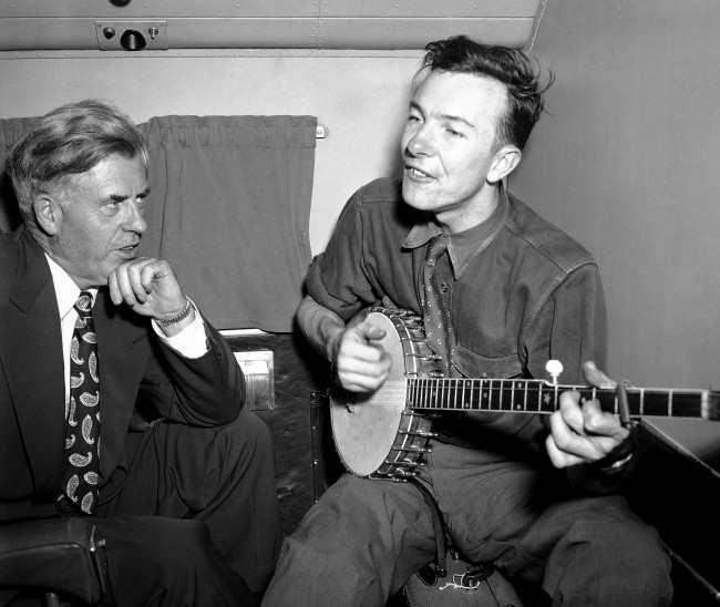 - In this Aug. 28, 1948 file photo, former Vice President and 1948 Progressive Party presidential candidate, Henry A. Wallace, making a political tour of the south, listens to Pete Seeger, on a plane between Norfolk and Richmond. Seeger's influence is incalculable. He's the rare artist whose music and message transcends time, speaking to his children and their children and on and on. The son of a socialist musicologist and a violinist, he began leading others in song at 8 and was introduced to protest music around 12. (AP Photo, File)
