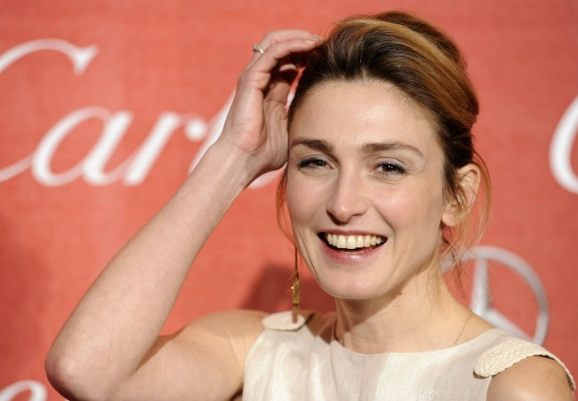 French actress Julie Gayet poses at the 2012 Palm Springs International Film Festival Awards Gala, Saturday, Jan. 7, 2012, in Palm Springs, Calif. (AP Photo/Chris Pizzello)