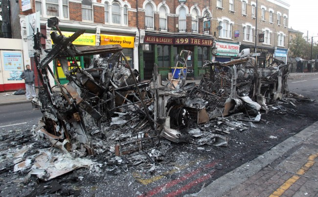 "The remains of a burned out bus in Tottenham, north London as trouble flared after members of the community took to the streets last night to demand ""justice"", after Mark Duggan, 29, was shot dead by police on Thursday. Picture date: Sunday August 7, 2011."