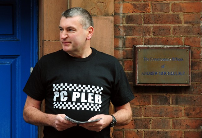 PC Mick Callaghan outside the constituency offices of MP Andrew Mitchell, for the launch of a poster campaign against police cuts, in Sutton Coldfield, West Midlands. Picture date: Wednesday September 26, 2012