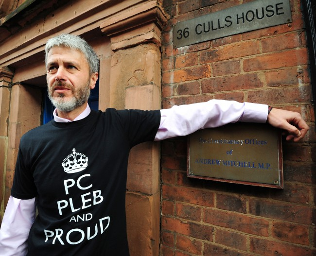 Chairman of Warwickshire Police Federation Simon Payne outside the constituency offices of MP Andrew Mitchell, for the launch of a poster campaign against police cuts, in Sutton Coldfield, West Midlands. Picture date: Wednesday September 26, 2012.