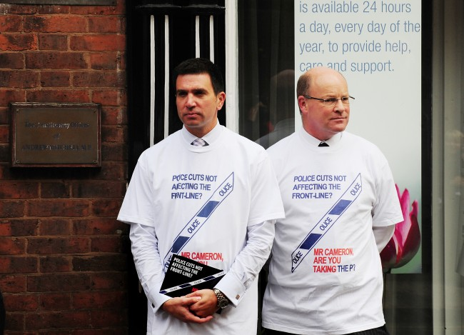 West Midlands police officers outside the constituency cffices of MP Andrew Mitchell, for the launch of a poster campaign against police cuts, in Sutton Coldfield, West Midlands. Picture date: Wednesday September 26, 2012.