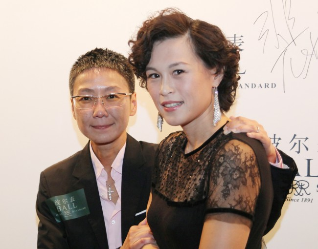 Gigi Chao, right, daughter of the Hong Kong property tycoon Cecil Chao, poses with her partner Sean Eav at an event in Hong Kong.
