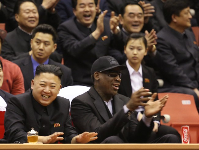 North Korean leader Kim Jong Un, left, and former NBA star Dennis Rodman watch North Korean and U.S. players in an exhibition basketball game at a sports arena in Pyongyang, North Korea. Rodman arrived in Pyongyang on Monday with three members of the Harlem Globetrotters basketball team to shoot an episode on North Korea for a new weekly HBO series.