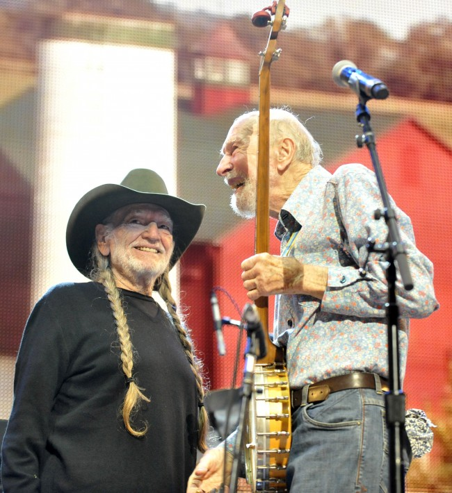 Pete Seeger and Willie Nelson on stage during the Farm Aid 2013 concert at Saratoga Performing Arts Center in Saratoga Springs, N.Y., Saturday, Sept. 21, 2013.(AP Photo/Hans Pennink)