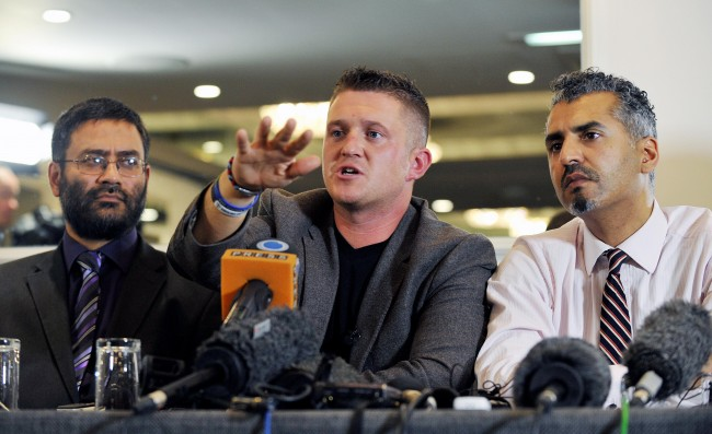 (left to right) Usama Hasan of the Quilliam Foundation, English Defence League (EDL) leader Tommy Robinson and Maajid Nawaz of the Quilliam Foundation, during a press conference at the Montague Hotel, central London, as Robinson announced that he is to stand down from the EDL under the guidance of the Quilliam foundation. Picture date: Tuesday October 8, 2013. Photo credit should read: Nick Ansell/PA Wire