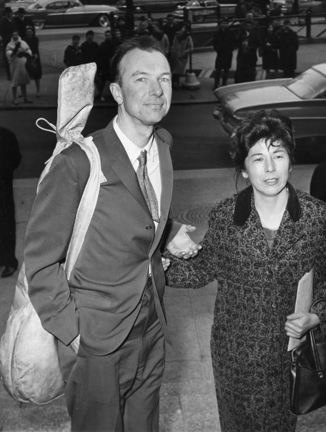 American folk singer Pete Seeger, a banjo slung over his shoulder, is accompanied by his wife Toshi, on his arrival at the Federal Court, in New York, on April 4, 1961, for sentencing on a conviction of contempt of a Congress charge. He was given a one-year sentence for refusing to answer questions about possible Communist affiliations. Before he was sentenced, Seeger asked Judge Thomas F. Murphy for permission to sing a song. The judge declined. (AP Photo)