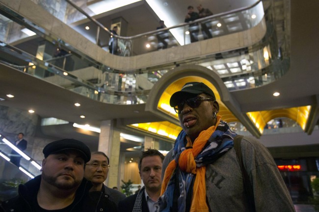 North Koreans look down from a balcony as former NBA basketball star Dennis Rodman enters the Koryo Hotel in Pyongyang