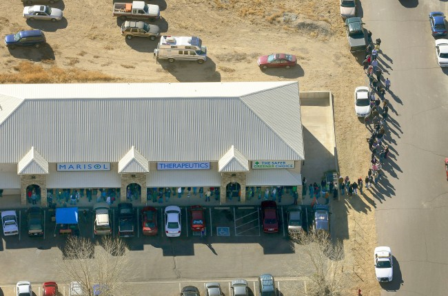 A long line of buyers trails from a store selling marijuana in Pueblo West, Colo, Wednesday, Jan. 1, 2014. The nation's first recreational pot industry opened in Colorado on Wednesday, kicking off a marijuana experiment that will be watched closely around the world.
