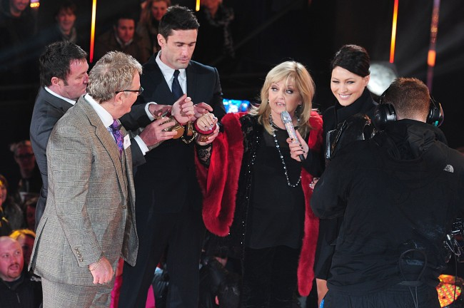 Presenter Emma Willis speaks to Linda Nolan and Jim Davidson as they are handcuffed together before entering the Celebrity Big Brother House, Elstree Studios, Hertfordshire.