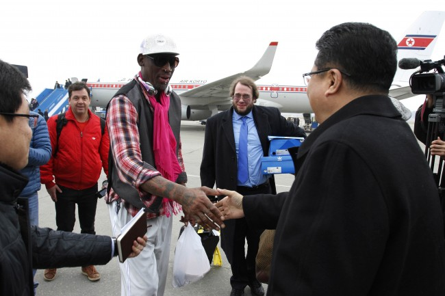 Former NBA basketball star Dennis Rodman shakes hands with North Korea's Sports Ministry Vice Minister Son Kwang Ho