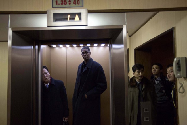Former NBA basketball star Charles D. Smith enters an elevator at a hotel in Pyongyang