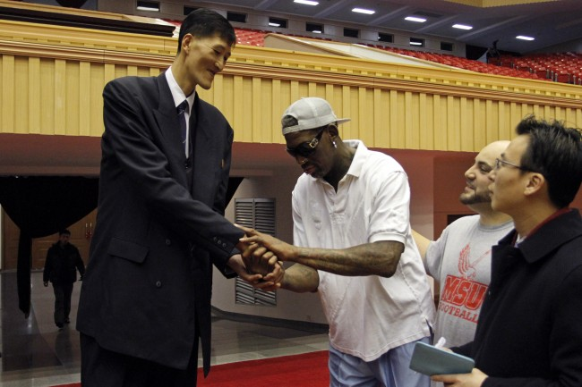 Dennis Rodman, center, meets with former North Korean basketball player Ri Myung Hun at a practice session with USA and North Korean players in Pyongyang, North Korea on Tuesday, Jan. 7, 2014.