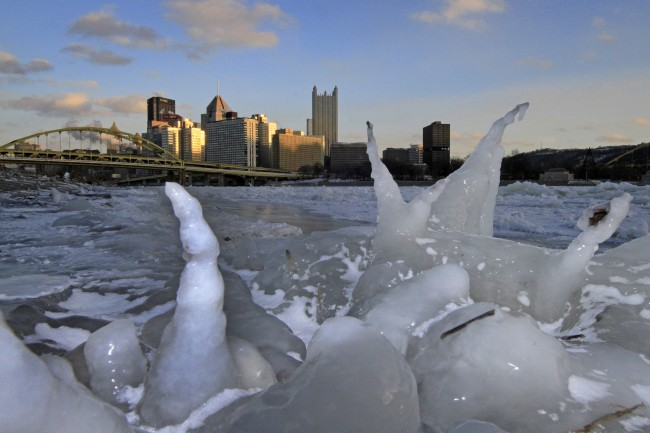 The skyline of Pittsburgh is framed by ice along the bank of the Allegheny river at sunset Tuesday, Jan. 7, 2014. Pittsburgh reached a low temperature of minus 9 degrees early Tuesday morning, and a high of 5 degrees. AP Photo/Gene J. Puska