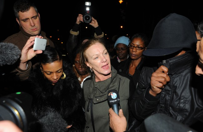 Mark Duggan's aunt Carol Duggan (centre) outside Tottenham police station, London, following an inquest jury finding his death at the hands of a police marksman was lawful, despite him being unarmed when he was shot. Picture date: Wednesday January 8, 2014.