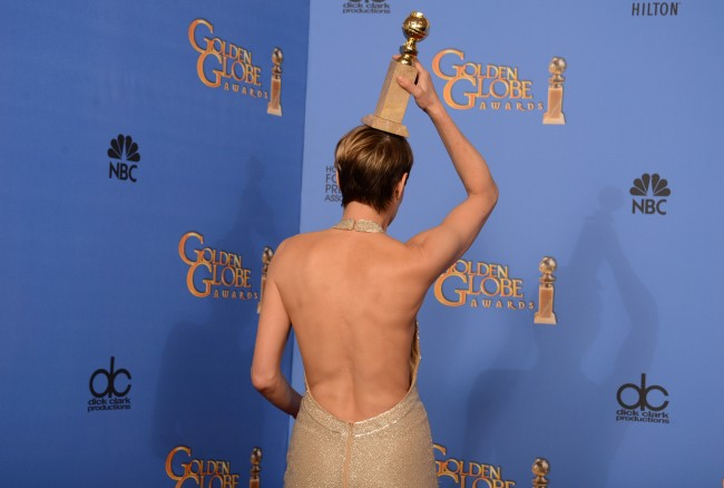 "Robin Wright poses in the press room with the award for best actress in a television series - drama for ""House of Cards"" at the 71st annual Golden Globe Awards at the Beverly Hilton Hotel on Sunday, Jan. 12, 2014, in Beverly Hills, Calif. (Photo by Jordan Strauss/Invision/AP)"