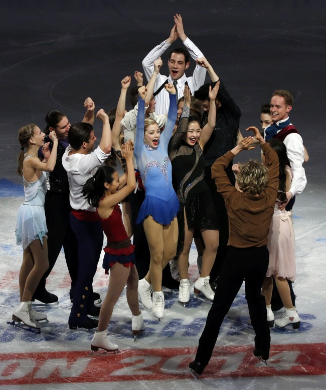 The U.S. Olympic figure skating team headed to Sochi do a group cheer on mid-ice at the end of their skating spectacular after the U.S. Figure Skating Championships in Boston, Sunday, Jan. 12, 2014. (AP Photo/Elise Amendola)