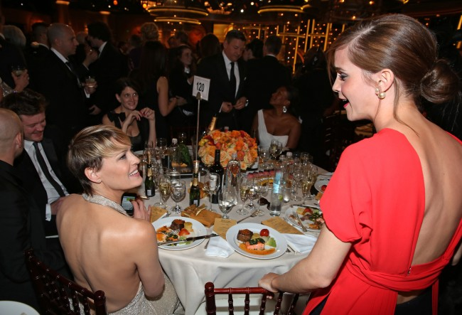 Robin Wright, left, and Emma Watson speak in the audience at the 71st annual Golden Globe Awards at the Beverly Hilton Hotel on Sunday, Jan. 12, 2014, in Beverly Hills, Calif. (Photo by Matt Sayles/Invision/AP)