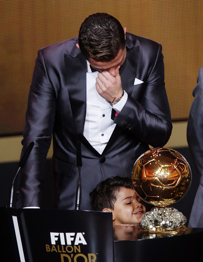 Real Madrid's Christiano Ronaldo of Portugal cries next to his son Ronaldo Junior after receiving the trophy for the world player at the FIFA Ballon d'Or 2013 Gala in Zurich, Switzerland, Monday, Jan. 13, 2014.