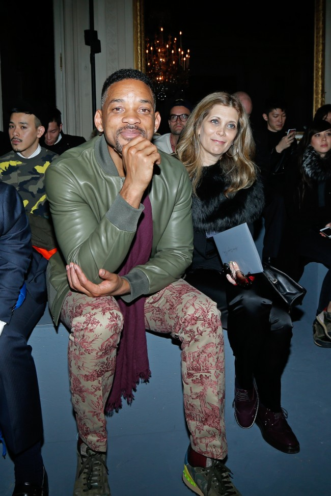 Actor Will Smith, centre, attends the Valentino's men's Fall-Winter 2014-2015 fashion collection, presented Wednesday, Jan. 15, 2014 in Paris. (AP Photo/Jacques Brinon)
