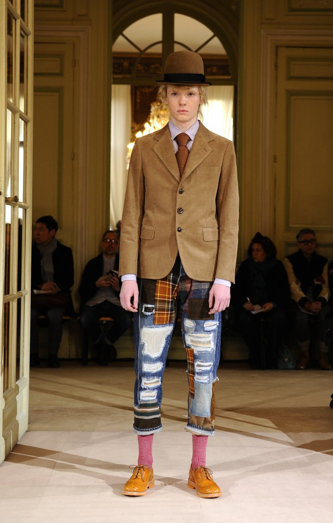 A model wears a creation during Watanabe men's fall-winter 2014-2015 fashion collection presented in Paris, Friday, Jan.17, 2014. (AP Photo/Zacharie Scheurer)
