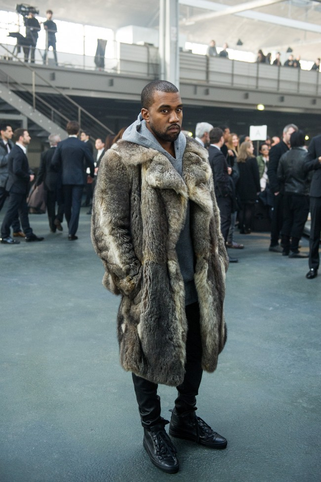 Singer Kanye West poses for photographers as he arrives to attend the Givenchy men's Fall-Winter 2014-2015 fashion collection, presented Friday, Jan. 17, 2014 in Paris. (AP Photo/Zacharie Scheurer)