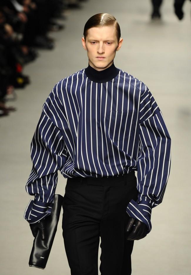 A model wears a creation for South Korean fashion designer Juun J's men fall-winter 2014-2015 fashion collection, presented in Paris, Friday, Jan.17, 2014. (AP Photo/Zacharie Scheurer)