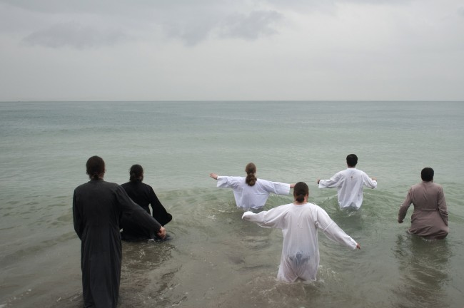 Orthodox priests and believers enter the Black Sea during Epiphany celebrations in Khosta, Sochi district Sunday, Jan. 19, 2014
